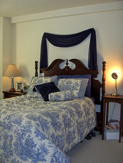 Sheer Curtains Over Bed: Curtain headboard with lights.